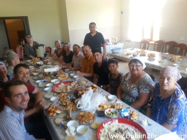 Kazakh Hospitality. Baghdad, in the background, invited us into his amazing home to have a feast with his lovely family. You can see the goat's head on the table behind him!