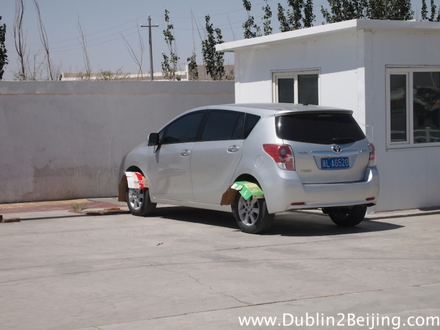 It was so hot this guy put cardboard over his tyres to stop them melting!