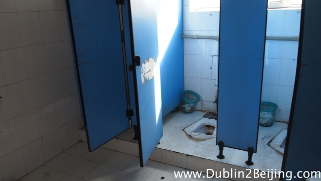 Squat toilet in petrol station China
