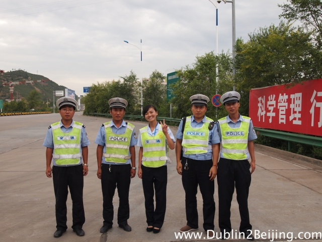 The cops who gave me an escort into the city. The chick in the middle worked on the toll booth and spoke English. Pretty cute too!