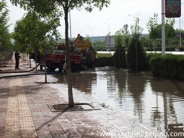 The lads pumping the flood waters back into the river near Zhongwei